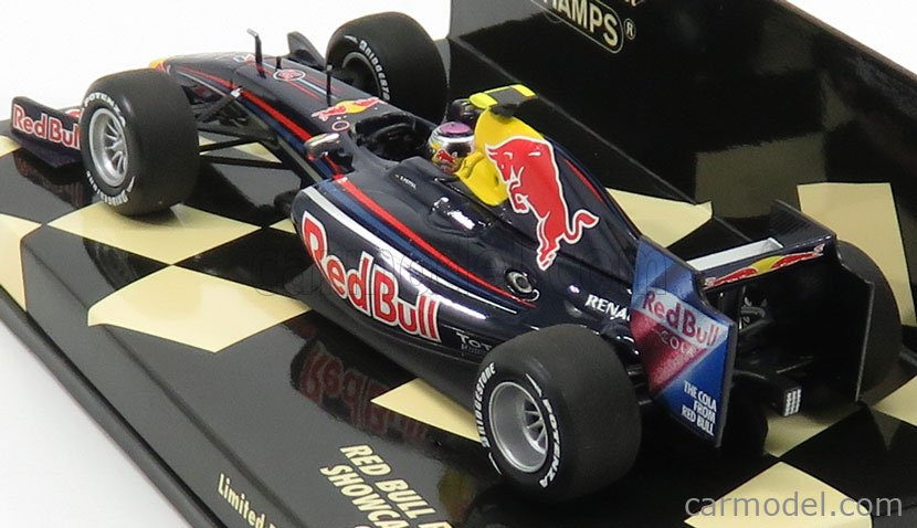 MINICHAMPS 400090085 Масштаб 1/43  RED BULL F1  RENAULT RB5 N 15 SHOWCAR 2009 S.VETTEL BLUE RED YELLOW